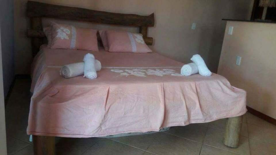 A bed or beds in a room at Pousada Paradise