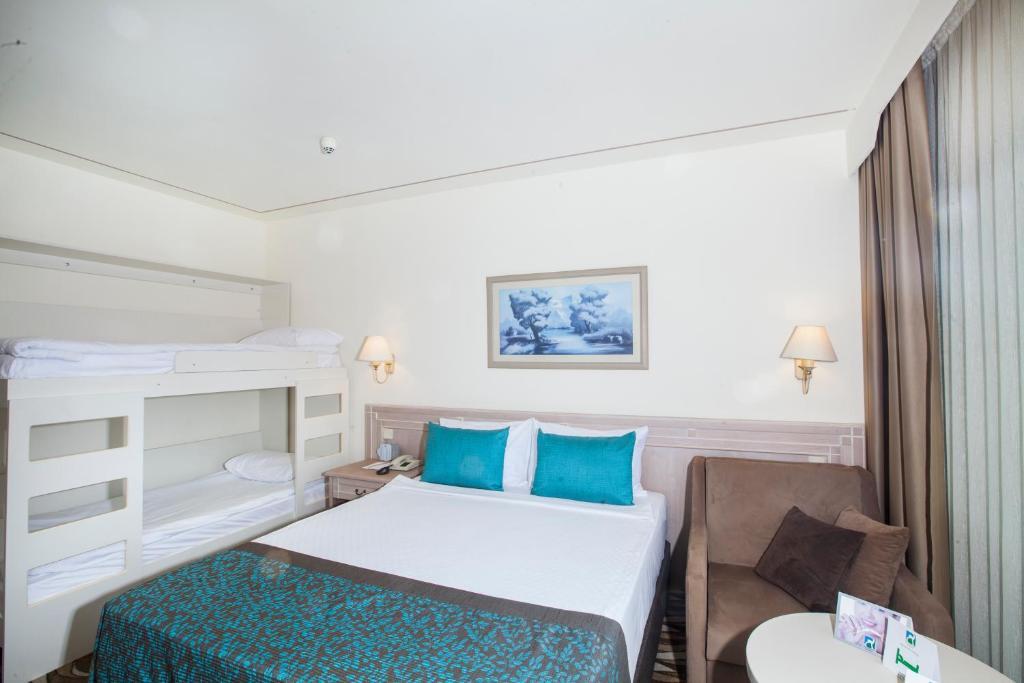 A bunk bed or bunk beds in a room at Fun & Sun Miarosa Ghazal Resort