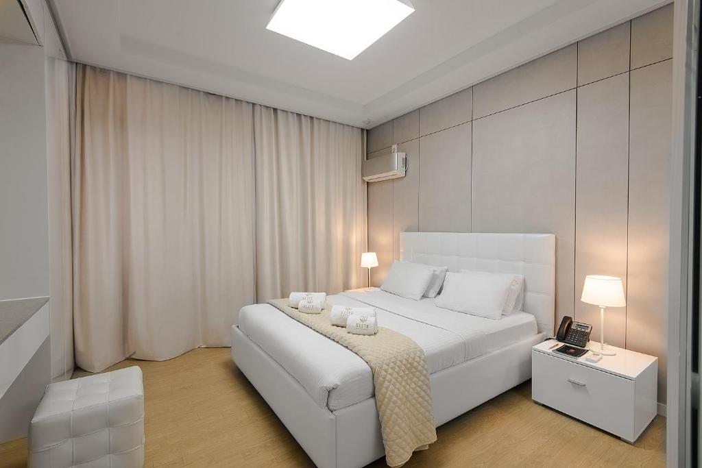 Кровать или кровати в номере Elite Apart-Hotel
