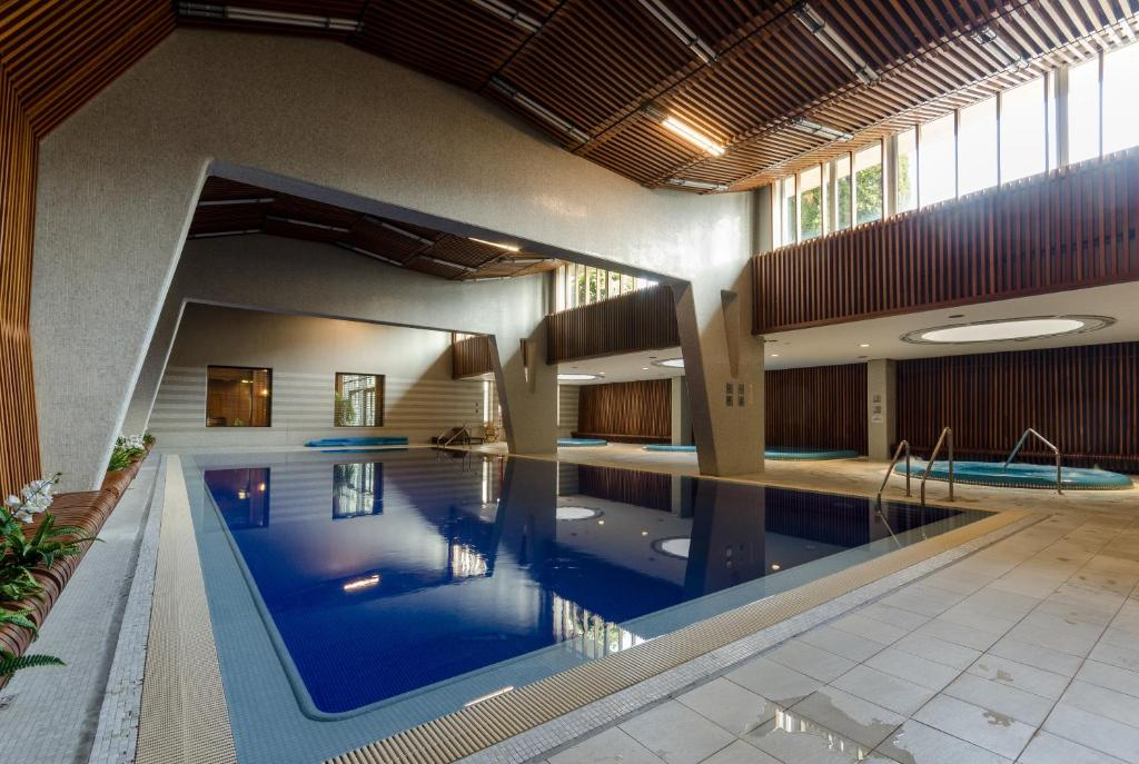 The swimming pool at or near Sweet Home at the Danube with wellness