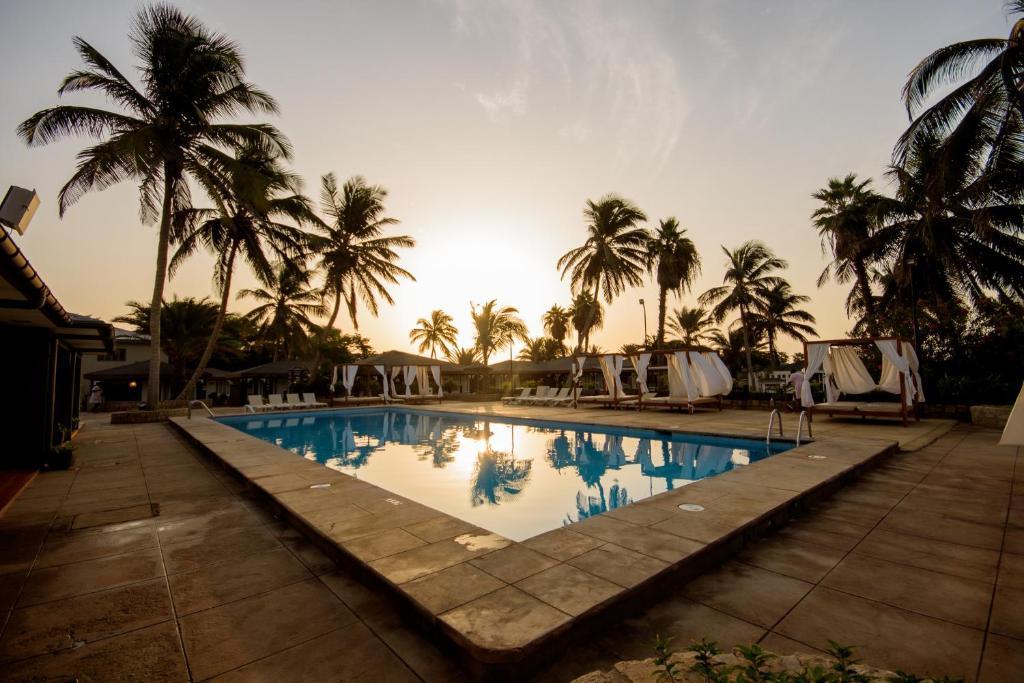 The swimming pool at or near Oasis Belorizonte