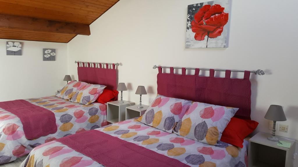 Un ou plusieurs lits dans un hébergement de l'établissement Le Grenier Elena
