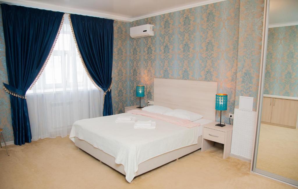 Кровать или кровати в номере Отель Старый Город
