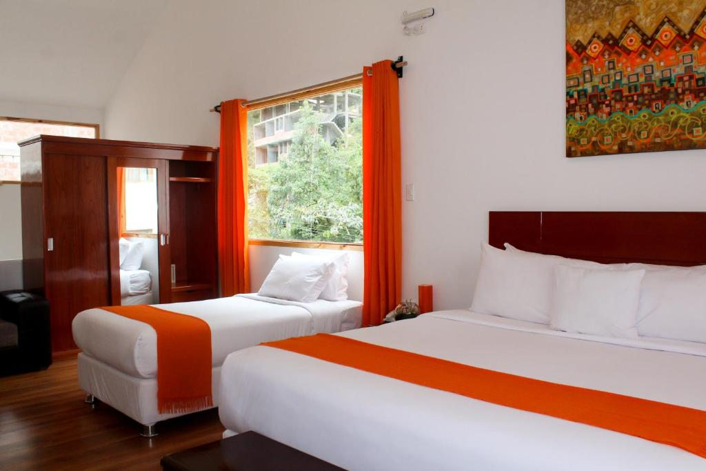 A bed or beds in a room at Waman Suites Machu Picchu