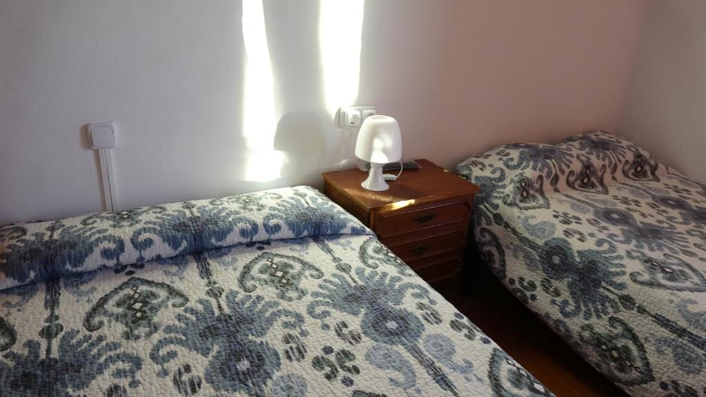 A bed or beds in a room at Hostal Bar Ruiz