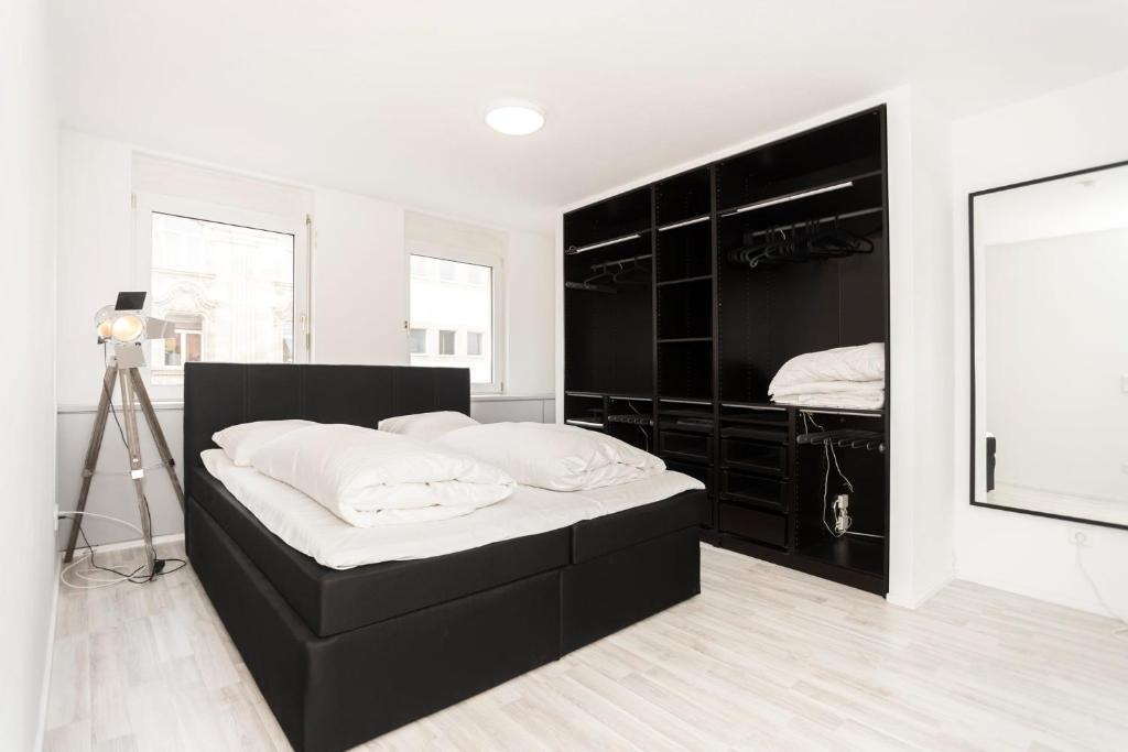 A bed or beds in a room at City Apartment by urbn rooms