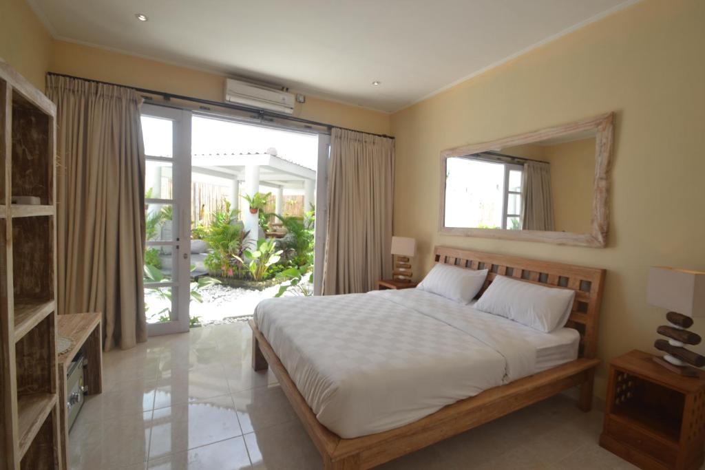 Un ou plusieurs lits dans un hébergement de l'établissement The Ricefields Canggu