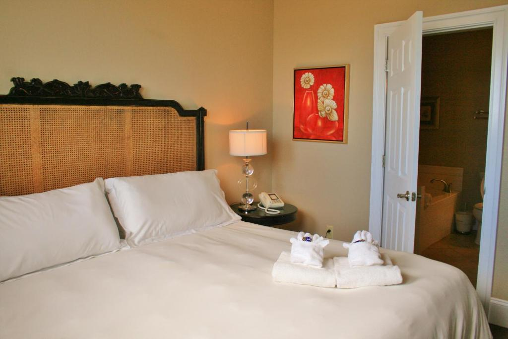 A bed or beds in a room at Oasis Suites Hotel