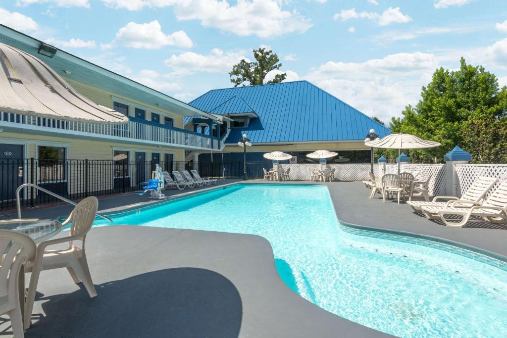 The swimming pool at or near Days Inn by Wyndham Savannah Airport