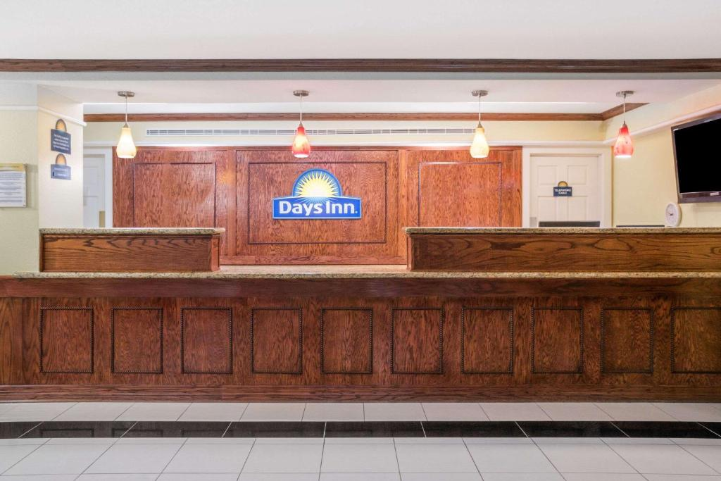 The lobby or reception area at Days Inn by Wyndham Houston