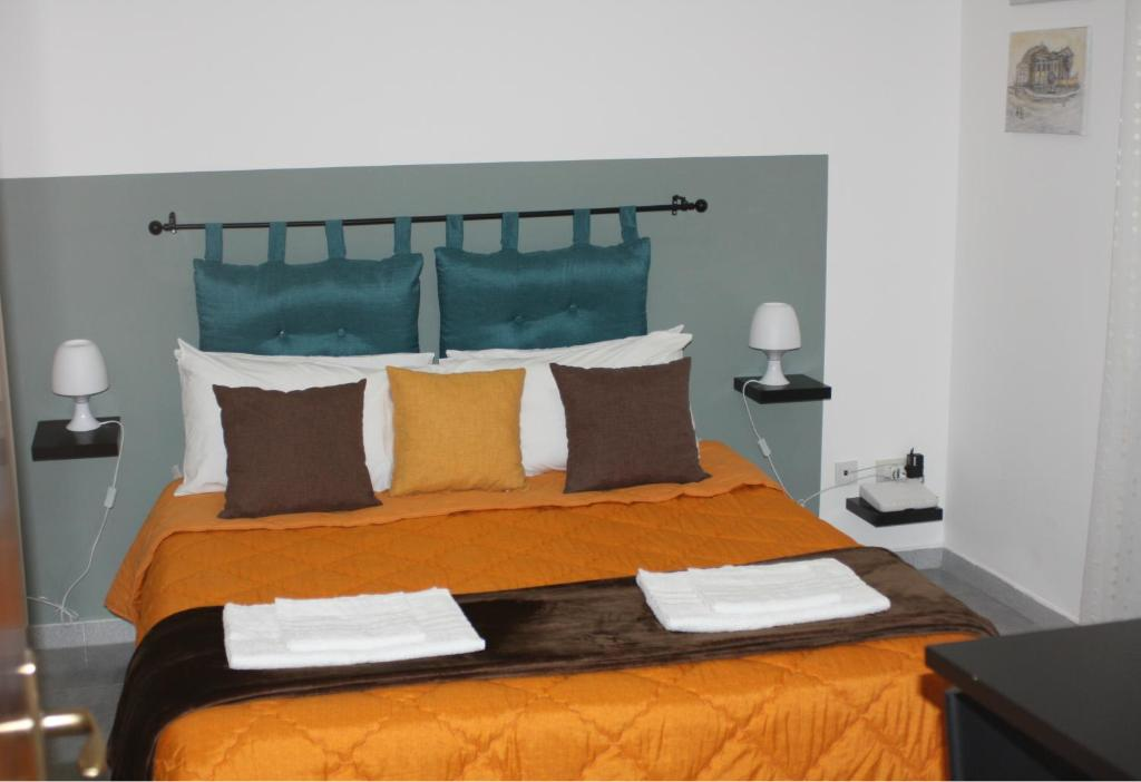 A bed or beds in a room at Panormus Room