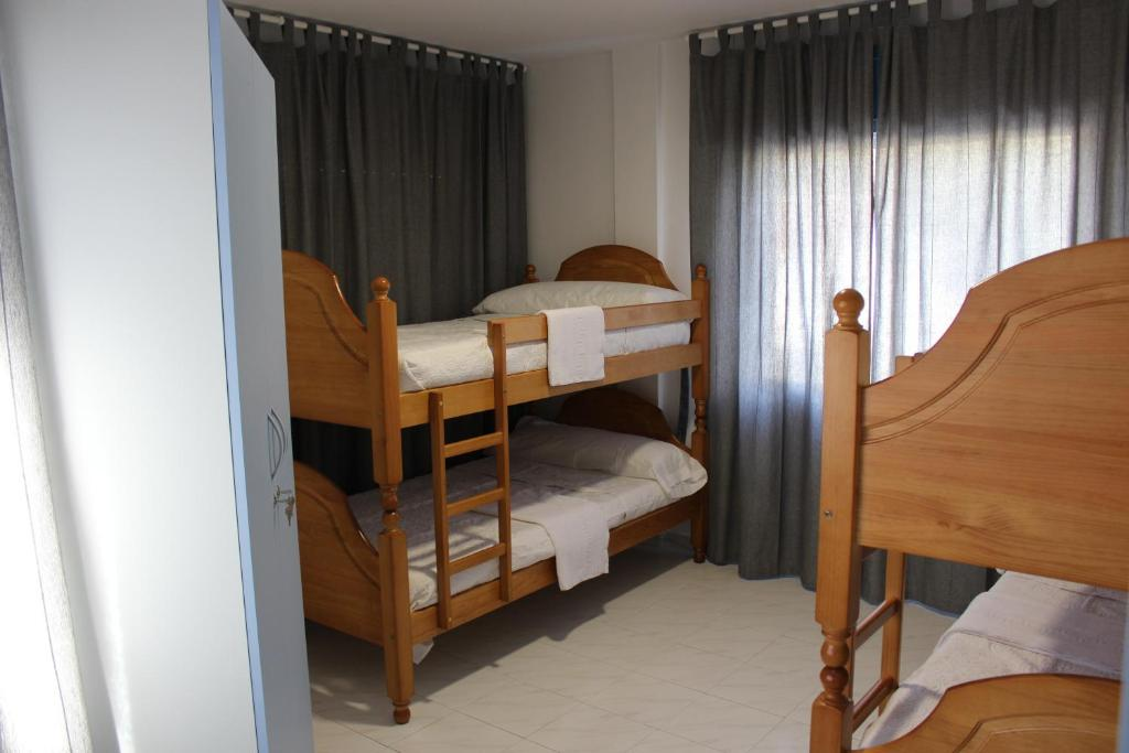 A bunk bed or bunk beds in a room at A Senda