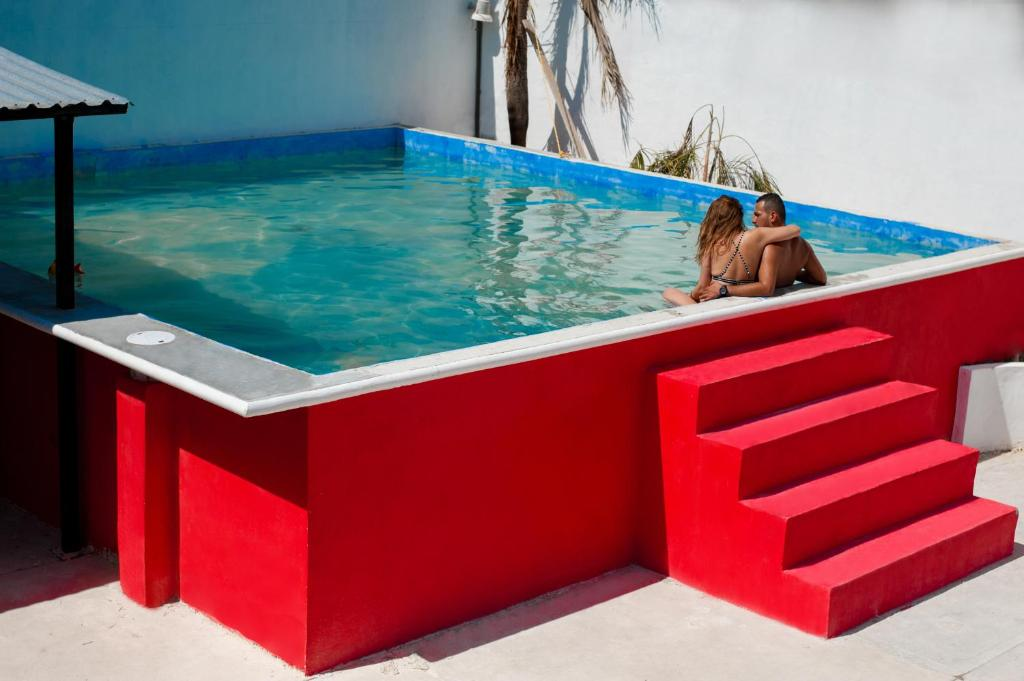 The swimming pool at or near Coco Hostel