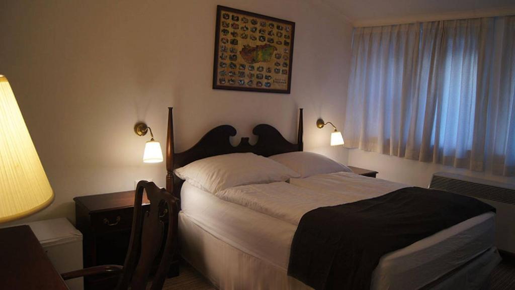 Letto o letti in una camera di Opera Loft Apartments