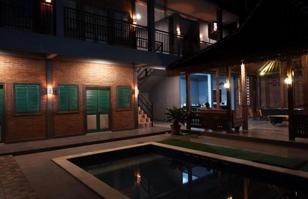 The swimming pool at or near Kayu Tua Villa