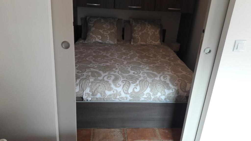 Un ou plusieurs lits dans un hébergement de l'établissement MAÏNI