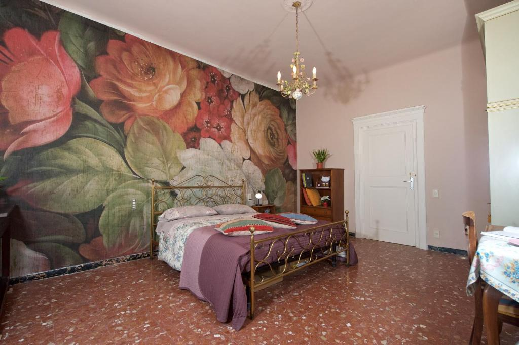 A bed or beds in a room at Liberi Mercanti