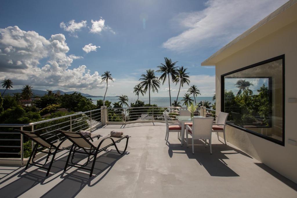 A balcony or terrace at Sam-kah Beachhouse Villa 7