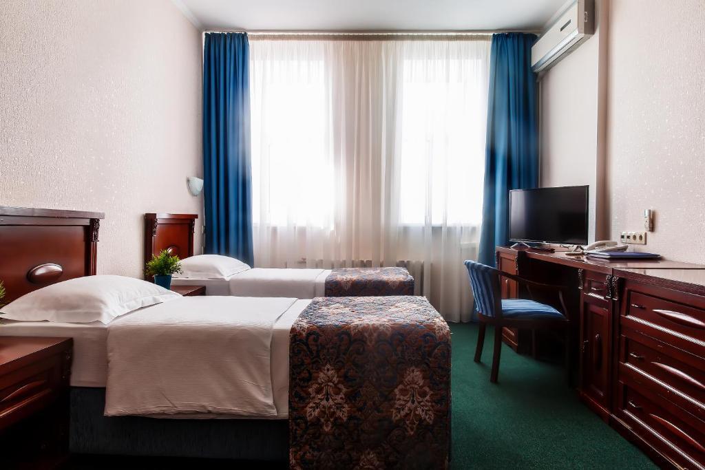 Кровать или кровати в номере Отель Тенгри
