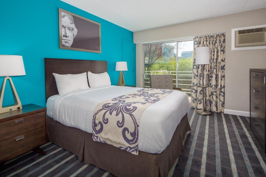 A bed or beds in a room at Americana Hotel