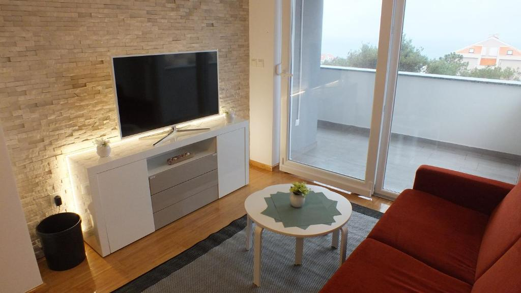 A television and/or entertainment center at Apartment Paulina