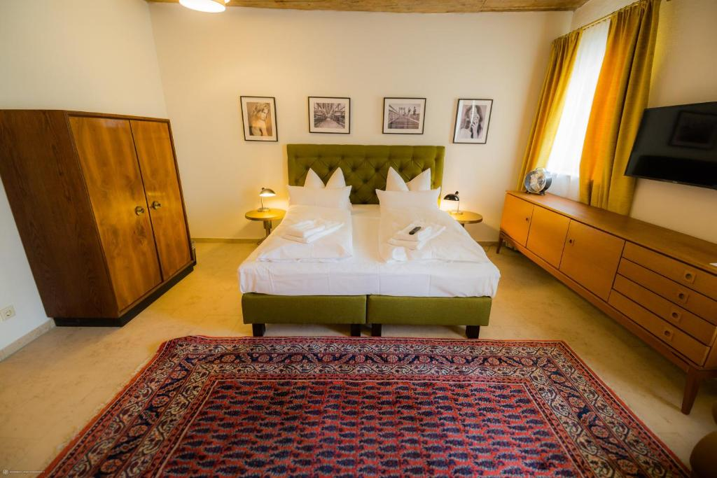 A bed or beds in a room at Hotel Luis Stadl