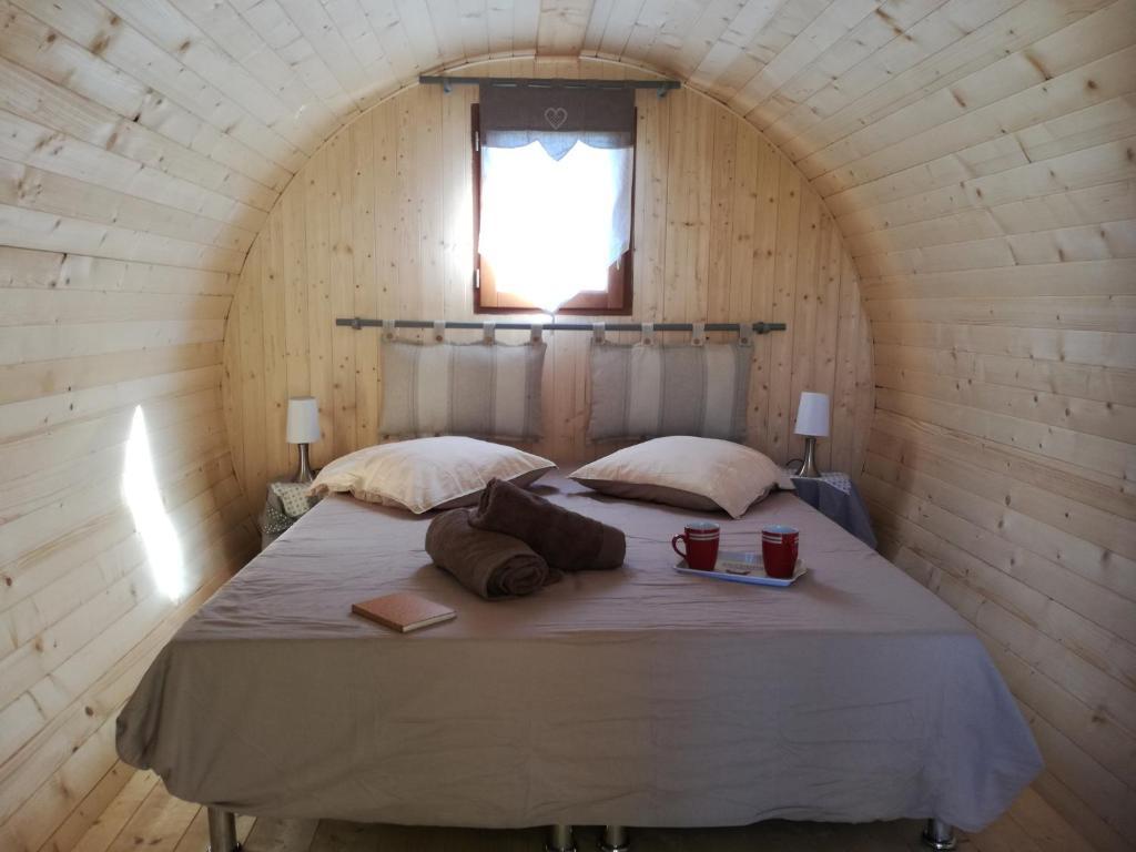 Un ou plusieurs lits dans un hébergement de l'établissement Ain'solite Tonn'ain - Repaire des Sources