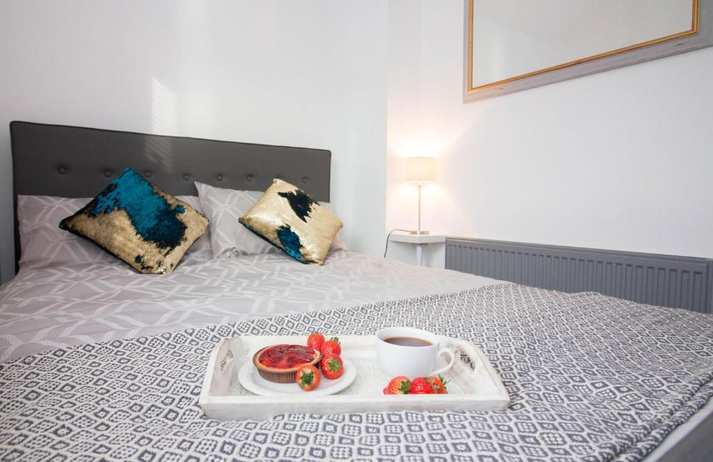 Posteľ alebo postele v izbe v ubytovaní Magdalen Quarters