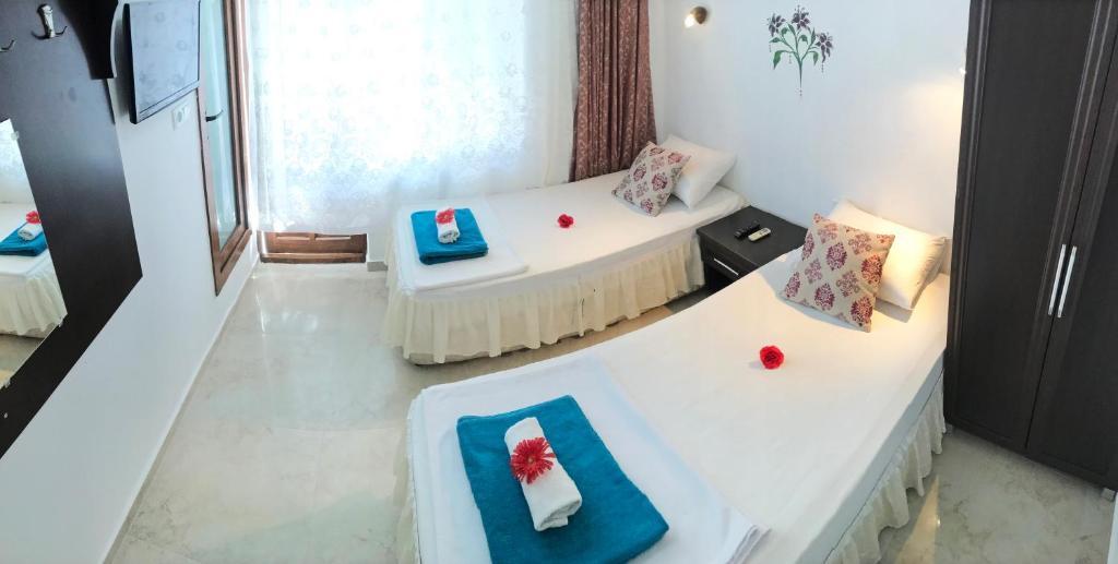 Кровать или кровати в номере Santosa Pension