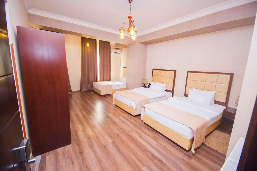 A bed or beds in a room at Orion Econom