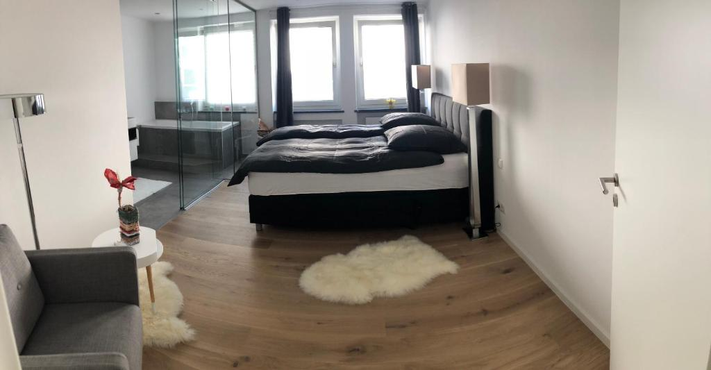 A bed or beds in a room at Apartment Central Würzburg