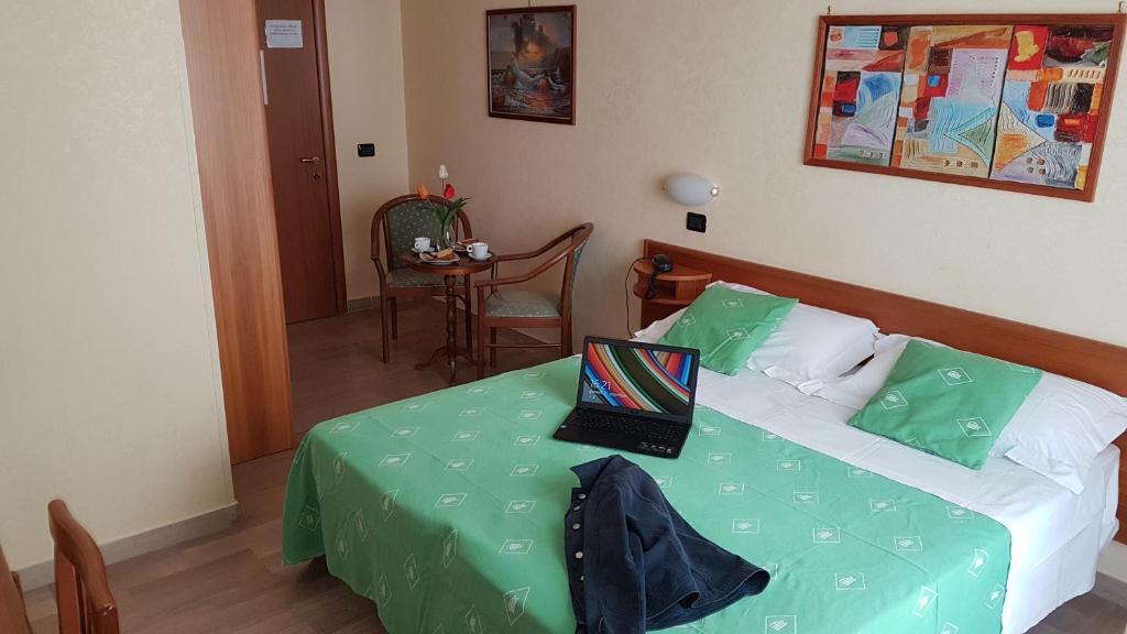Letto o letti in una camera di Hotel Aurora