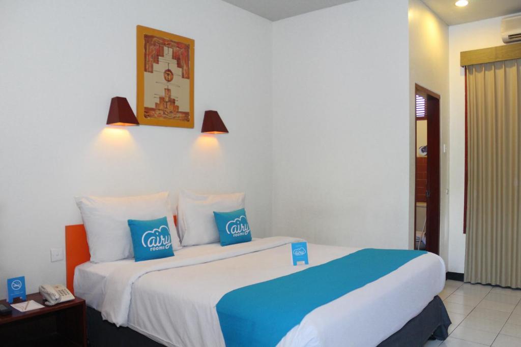 Un ou plusieurs lits dans un hébergement de l'établissement Airy Denpasar Selatan Bypass Ngurah Rai 660 Bali