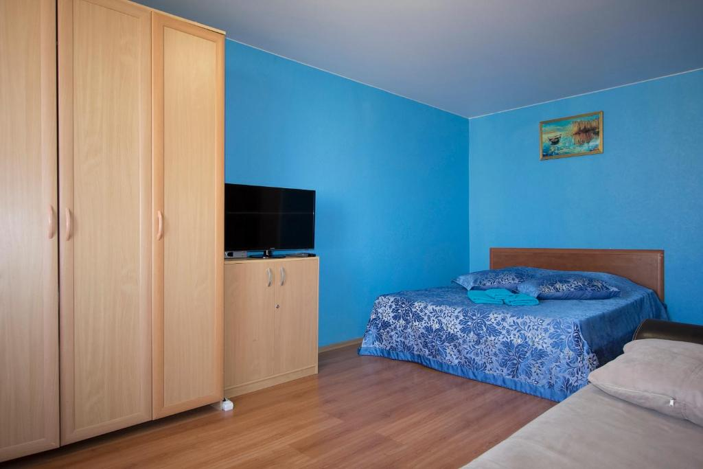 A bed or beds in a room at ApartLux Sokolnicheskaya Superior
