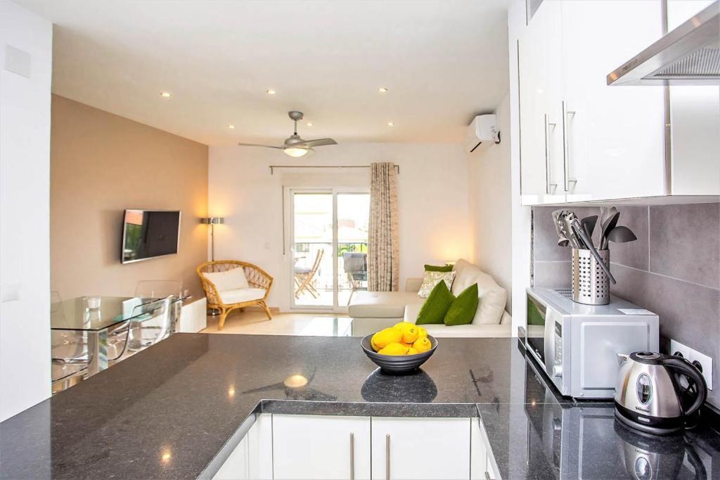 A kitchen or kitchenette at Sea View Apartment at urbanisation Las Farolas