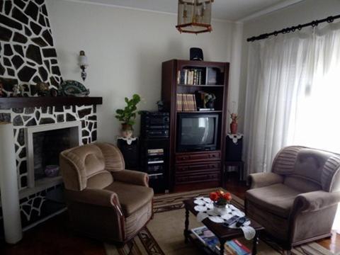 A seating area at Casa Teixeira - Junto à Oficina