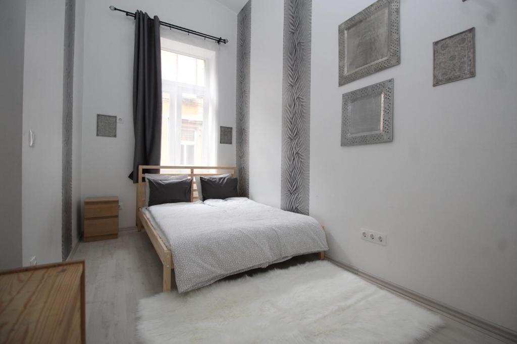 Ein Bett oder Betten in einem Zimmer der Unterkunft Pest Inn