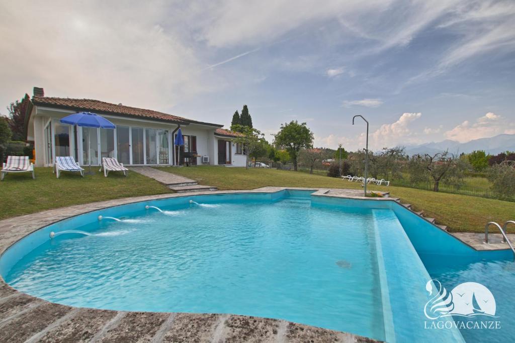 The swimming pool at or near Villa Elena