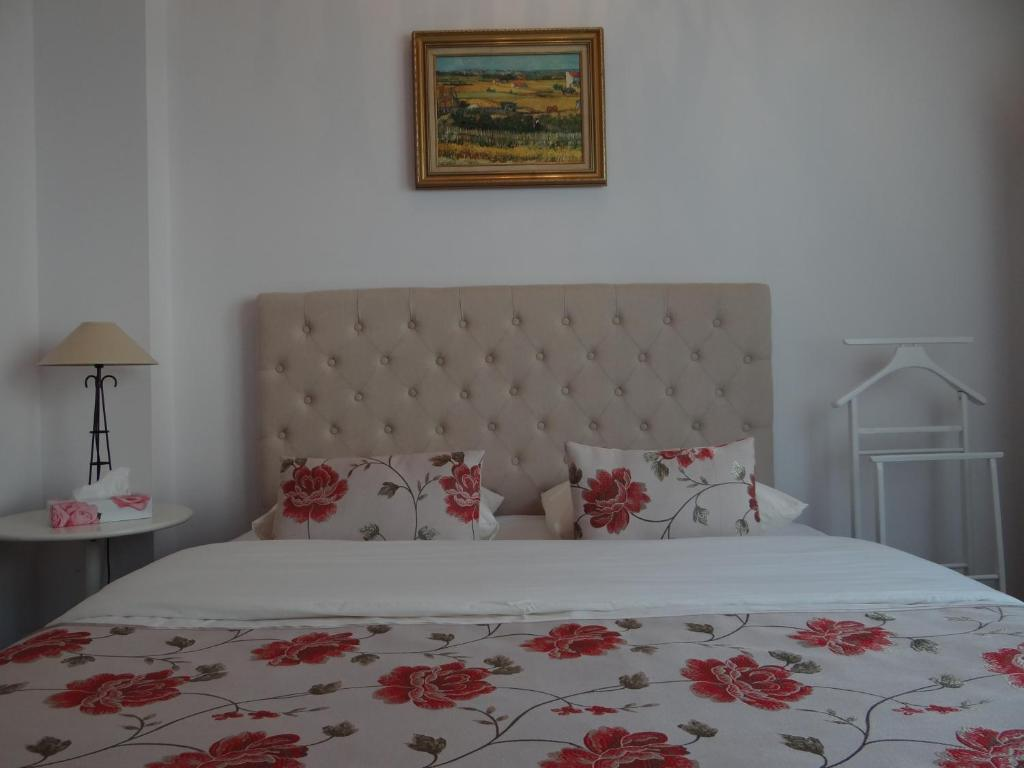 A bed or beds in a room at Villa Colonna Appartements