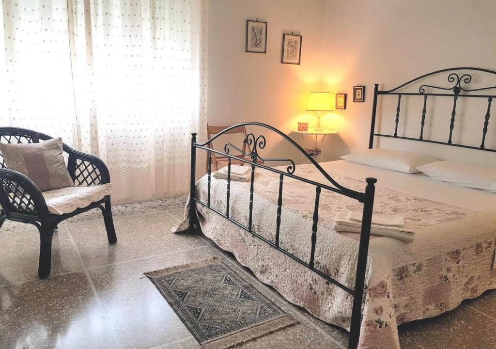Letto o letti in una camera di La Coccinella Guest House Self Check-in