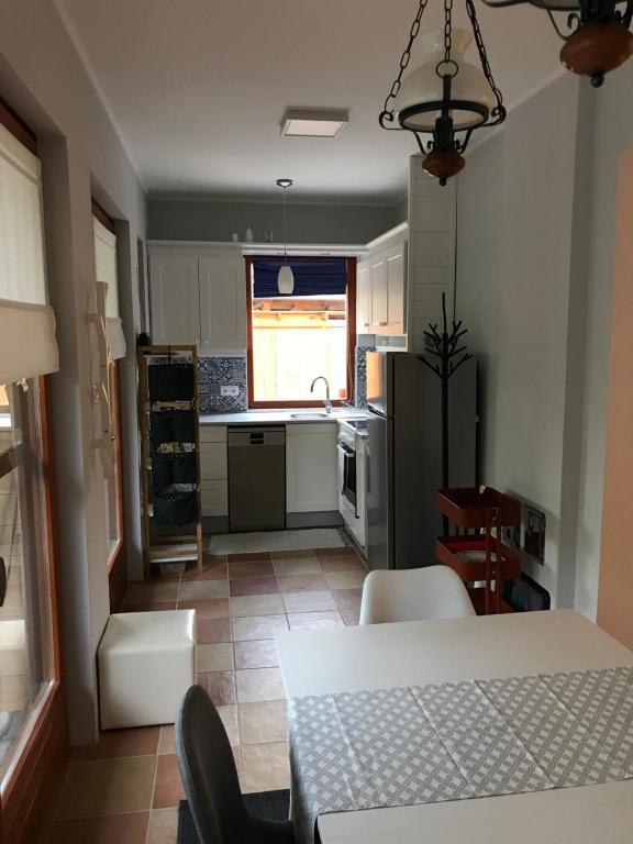 A kitchen or kitchenette at Kakas Vendégház