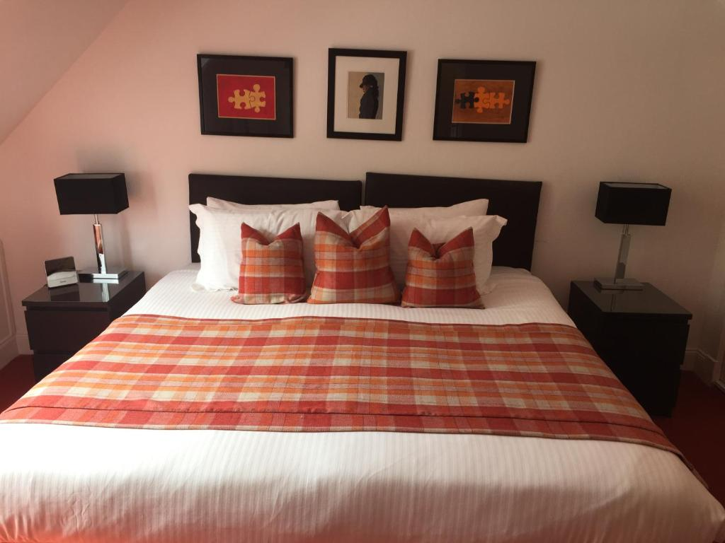 A bed or beds in a room at The Golden Larches