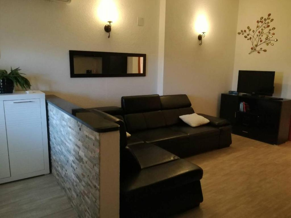 A seating area at Apartment Rina