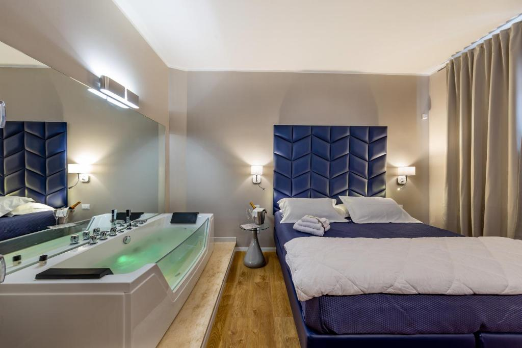 A bed or beds in a room at Album Boutique Rooms