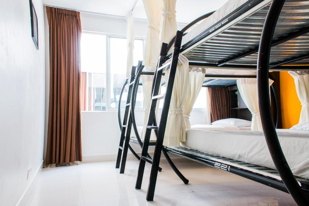 A bunk bed or bunk beds in a room at Sla Boutique Hostel