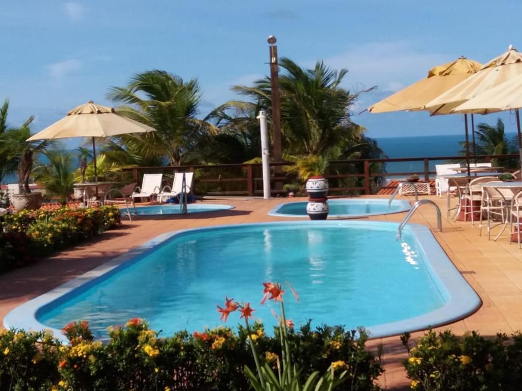 The swimming pool at or near Pousada Cultural Canto dos Poetas