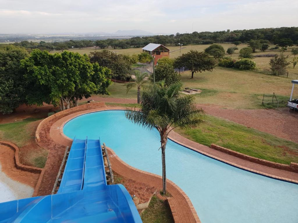 A view of the pool at hartbeespoort holiday resort or nearby