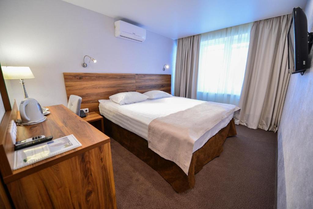 Кровать или кровати в номере Чайка Отель