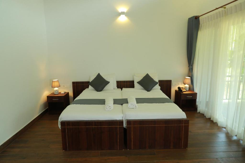 A bed or beds in a room at Sattva-The Awakening Garden