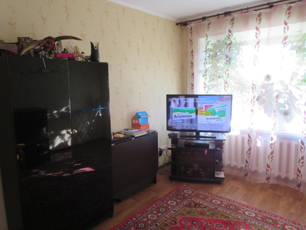 A television and/or entertainment center at Апартаменты на Чемпионат